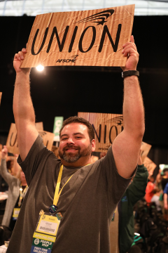 Union member holding union sign